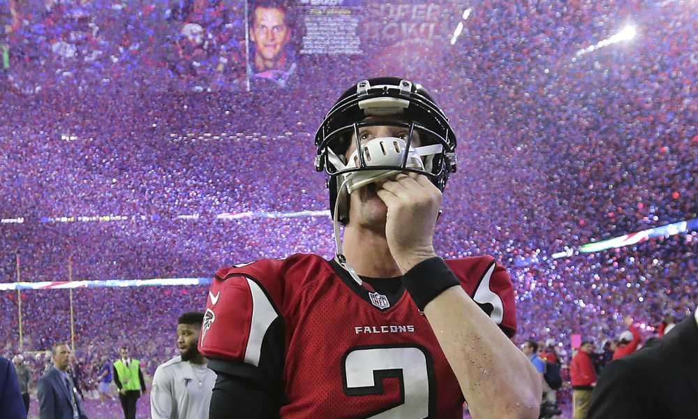 February 5, 2017, Houston: Falcons quarterback Matt Ryan reacts to losing the Super Bowl as the screen flashes Patriots quarterback Tom Brady and the confetti flys in a 34-28 loss on Sunday Feb. 5, 2017, in Houston.    Curtis Compton/ccompton@ajc.com