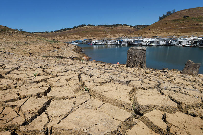 Dried+mud+and+the+remnants+of+a+marina+is+seen+at+the+New+Melones+Lake+reservoir+which+is+now+at+less+than+20+percent+capacity+as+a+severe+drought+continues+to+affect+California+on+May+24%2C+2015.++California+has+recently+announced+sweeping+statewide+water+restrictions+for+the+first+time+in+history+in+order+to+combat+the+region%27s+devastating+drought%2C+the+worst+since+records+began.++++++++++AFP+PHOTO%2F+MARK+RALSTON++++++++%28Photo+credit+should+read+MARK+RALSTON%2FAFP%2FGetty+Images%29