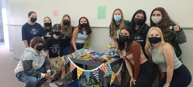 ASB+students+going+around+with+their+treat+cart+surprising+teachers.